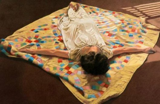 Woman Face Down On A Quilt